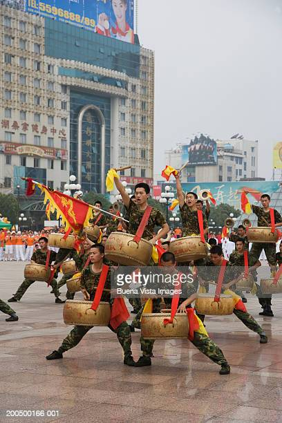 China, Guangxi Province, Guilin, people performing in square