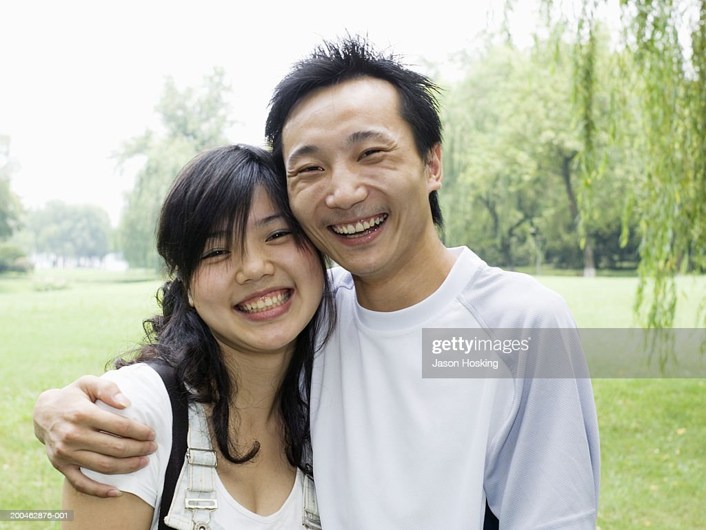 China, Hangzhou, West Lake, young couple smiling : Stock Photo