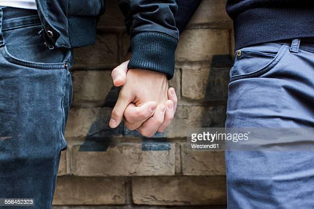 China, Hong Kong, close-up of gay couple holding hands