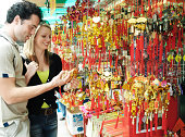 China, Hong Kong, couple at stall by Po Lim Temple, smiling