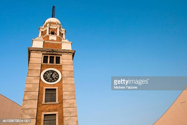 China, Hong Kong, Kowloon, Tsim Sha Tsui, Old clock tower, low angle view