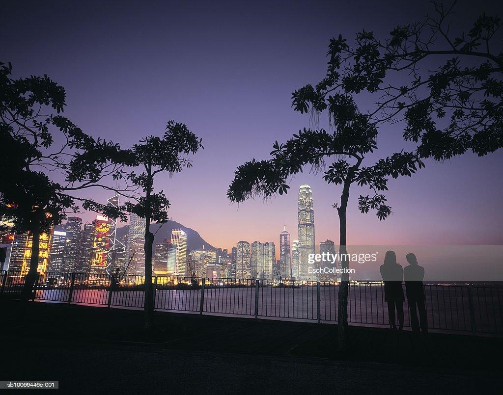 China,  Hong Kong (Island), Silhouette of two persons watching sunset at Hong Kong : Stock Photo