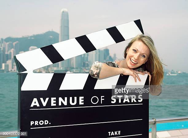 China, Hong Kong, woman on giant 'Avenue of Stars' clapperboard
