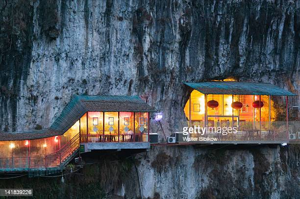 China, Hubei Province, Yichang, Hanging Restaurant by 3 Travelers Cave Park near Yangzi River, Evening
