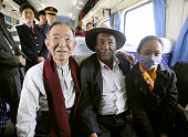 LHASA China Japanese Ambassador to China Uichiro Niwa poses with a Tibetan man on a train bound for Lhasa on Aug 17 2011 Niwa arrived in the Tibetan...