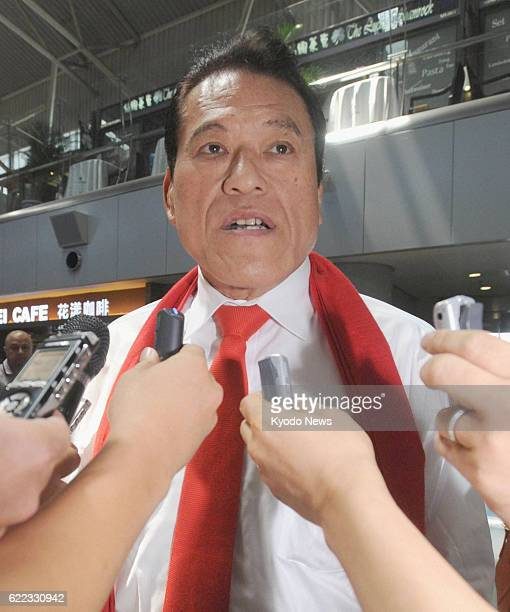BEIJING China Japanese wrestlerturnedlawmaker Antonio Inoki answers reporters' questions upon arriving at Beijing airport on July 25 en route to...
