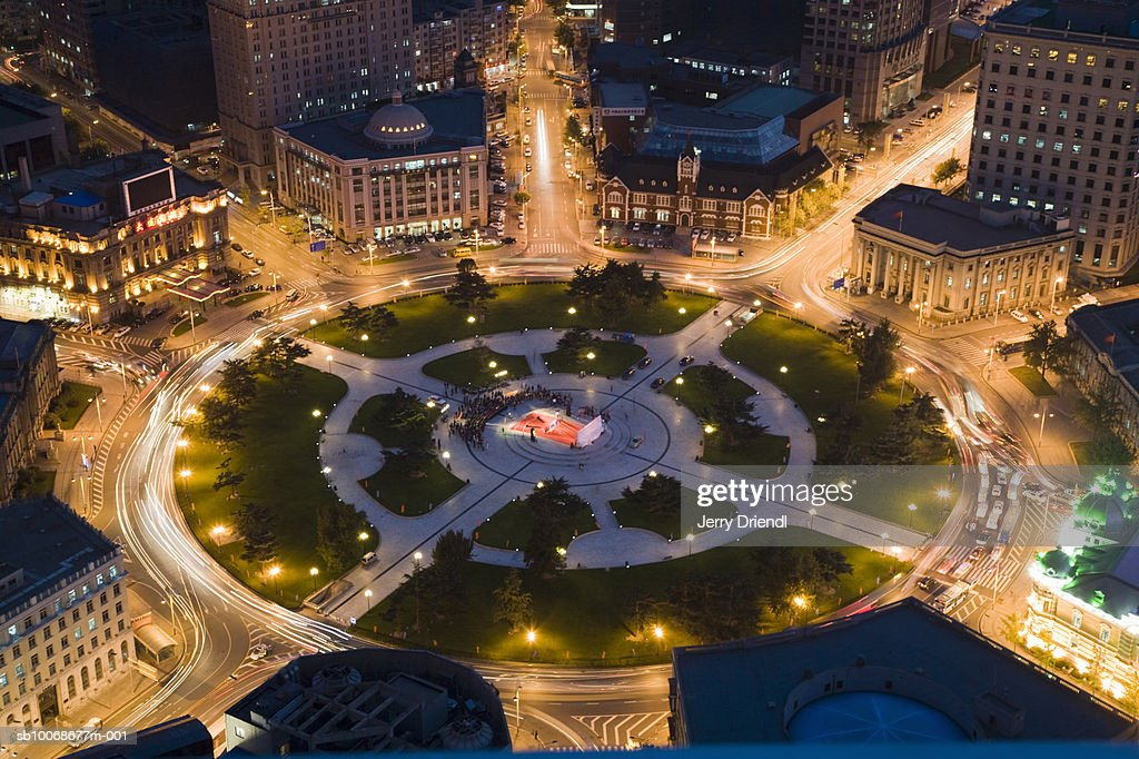 China, Liaoning Province, Dalian, Zhongshan Square illuminated at night, aerial view