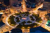 China, Liaoning Province, Dalian, Zhongshan Square illuminated at night, aerial view