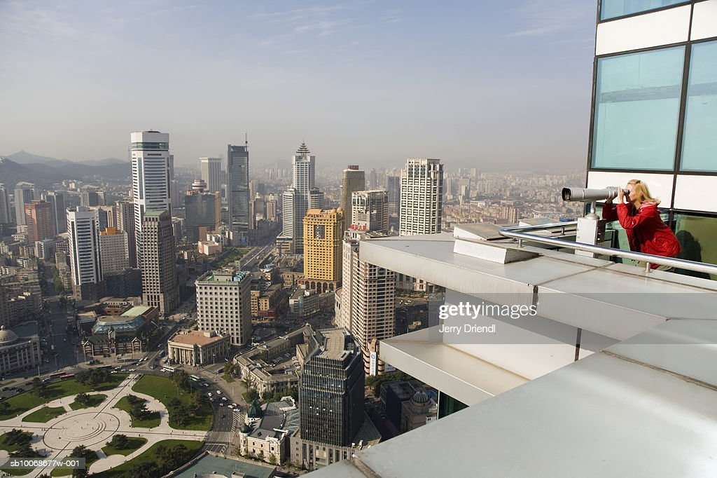 China, Liaoning Province, Zhongshan District, tourist on observation deck viewing Dalian skyline