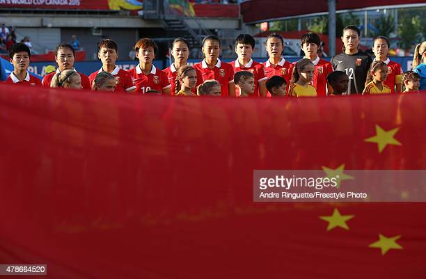 China line up for the national anthems prior to the match against the United States in the FIFA Women's World Cup 2015 Quarter Final match at...