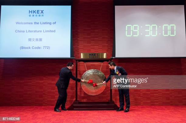 China Literature Limited CoChief Executive Officers Liang Xiaodong and Wu wenhui hit a gong to launch the companies Intial Public Offering at the...