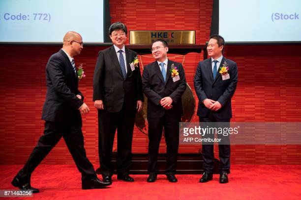 China Literature Limited CoChief Executive Officers Liang Xiaodong and Wu wenhui attend the companies Intial Public Offering at the Hong Kong Stock...