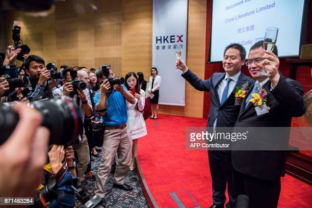 China Literature Limited CoChief Executive Officers Liang Xiaodong and Wu wenhui pose for photos at the companies Intial Public Offering at the Hong...
