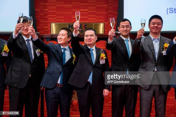 China Literature Limited CoChief Executive Officers Liang Xiaodong and Wu wenhui rase champagne glasses at the companies Intial Public Offering at...