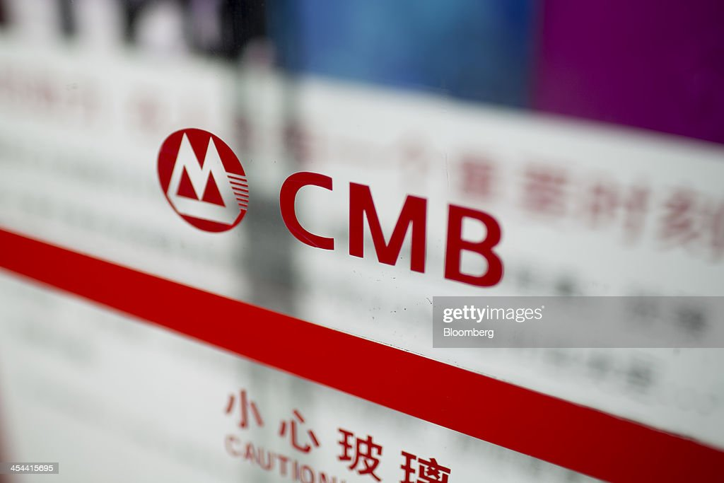 A China Merchants Bank Co. logo is displayed at a branch in the Tianhe district of Guangzhou, Guangdong province, China, on Monday, Nov. 25, 2013. China is proposing the largest package of economic reforms since the 1990s to stoke growth in the worlds biggest emerging market. Photographer: Brent Lewin/Bloomberg via Getty Images