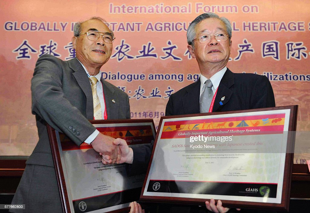 BEIJING China Nanao Mayor Bumpei Takemoto and Sado Mayor Koichiro Takano hold certificates of the Globally Important Agricultural Heritage Systems in...