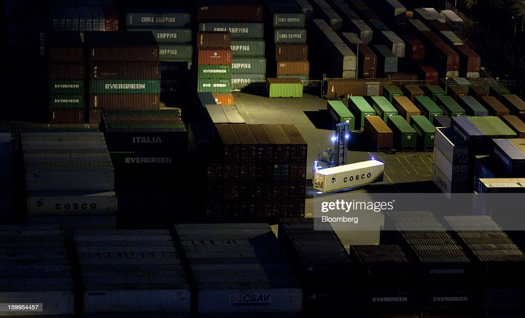 A China Ocean Shipping Group Co. (Cosco) container is illuminated as it is transported at a shipping terminal at night in Tokyo, Japan, on Wednesday, Jan. 23, 2013. Japan's exports fell more than analysts forecast and the annual trade deficit swelled to a record, bolstering the case for Prime Minister Shinzo Abe to weaken the yen even as trade tensions mount. Photographer: Tomohiro Ohsumi/Bloomberg via Getty Images