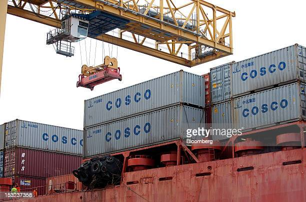 China Ocean Shipping Group Co freight containers sit onboard the Jolly Grigio dry cargo ship operated by Ignazio Messina C SpA at Genoa port in Genoa...