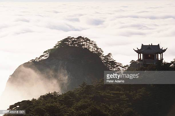 China, Pagoda on Huang Shan Mountains surrounded by clouds