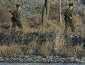 DANDONG China Patrolling North Korean soldiers are seen from an area in Dandong in Liaoning Province on the ChinaNorth Korea border on Dec 20 a day...