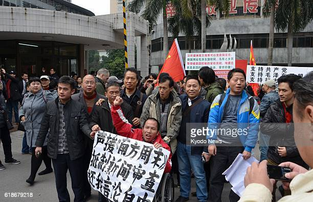 GUANGZHOU China People continue to gather outside the office of the Southern Weekly in Guangzhou in China's Guangdong Province on Jan 8 to show...