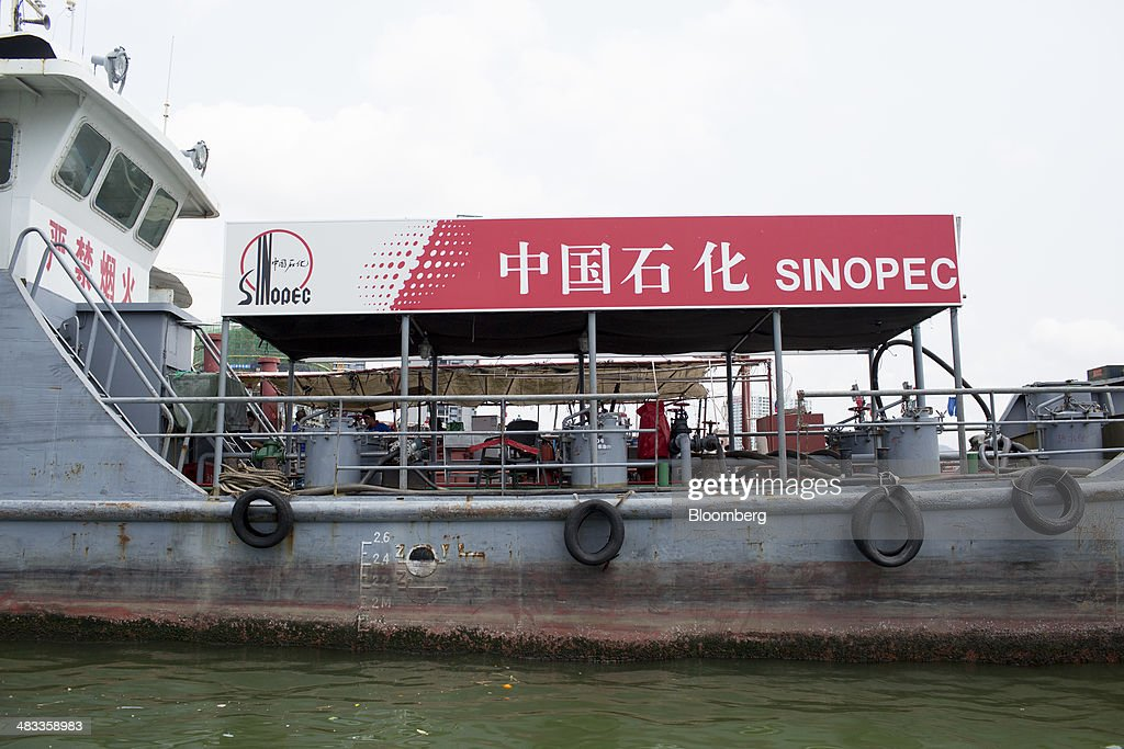 A China Petroleum & Chemical Corp. (Sinopec) floating gas station operates in the Sanya Bay district of Sanya, Hainan Province, China, on Monday, April 7, 2014. The yuan is poised to recover from declines that have made it Asia's worst-performing currency as China seeks to prevent an exodus of capital that would threaten economic growth, according to the most accurate forecasters. Photographer: Brent Lewin/Bloomberg via Getty Images
