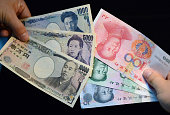 BEIJING China Photo shows bills in yen and yuan Direct trading in the Japanese and Chinese currencies bypassing the US dollar began on June 1 in a...