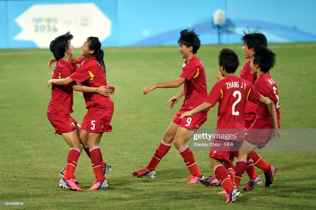 China players celebrate after winning the penalty shoot out after the full time scoreless draw during the 2014 FIFA Girls Summer Youth Olympic Football Tournament Semi Final match between China and Slovkia at Wutaishan Stadium on August 23, 2014 in Nanjing, China.
