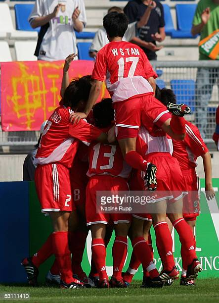China players celebrate Tao Chen scoring a goal during the FIFA World Youth Championship match between China and Germany on June 21 2005 in Tilburg...
