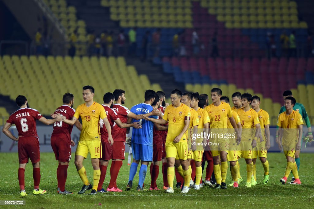 All National Teams PES 2013 - Page 2 China-players-shake-hands-with-syria-players-after-the-match-during-picture-id695734700