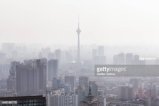 China pollution smog over the city overview roof
