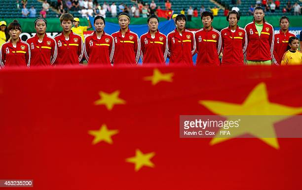 China PR stands together prior to facing Brazil at Commonwealth Stadium on August 5 2014 in Edmonton Canada