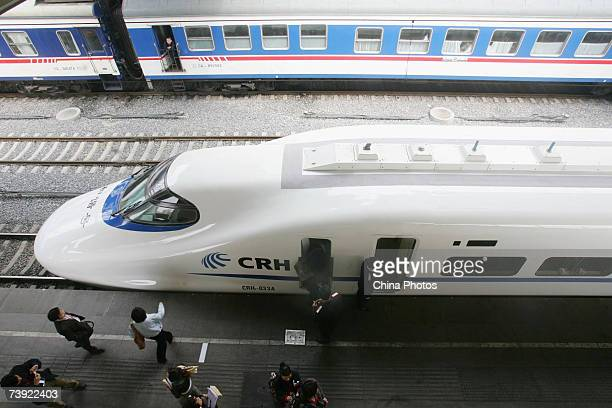 A China Railway Highspeed bullet train designed to run at a speed of 200 km per hour leaves the Beijing Railway Station on April 18 2007 in Beijing...