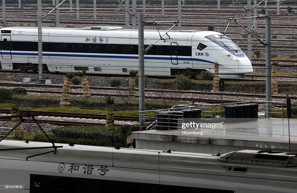 A China Railways high speed train, top, arrives at Hongqiao Railway Station in Shanghai, China, on Friday, Feb. 8, 2013. A record 3.41 billion passenger trips may be made this year during the Lunar New Year period, according to the National Development and Reform Commission. Photographer: Tomohiro Ohsumi/Bloomberg via Getty Images