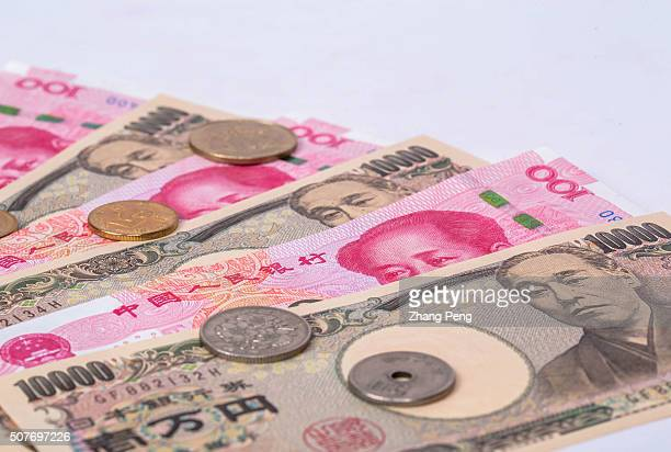 China RMB and Japanese Yen arranged for photography The economic fates of China and Japan are closely connected The interaction of currencies between...