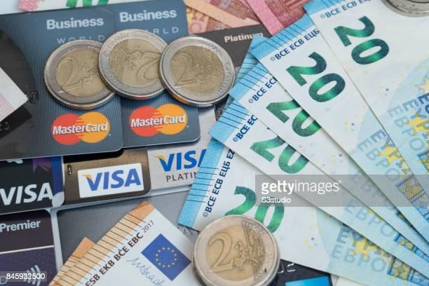 China RMB bank note US dollar Euro coins credit card of VISA AMERICAN and Master are arranged for a photograph on 11 September 2017 in Hong Kong Hong...