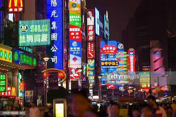 China, Shanghai, neon lights and people on Nanjing Road, night