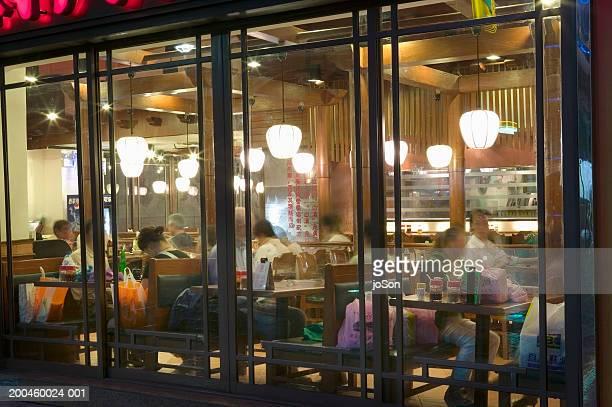 China, Shanghai, people in cafe at night (long expsosure)