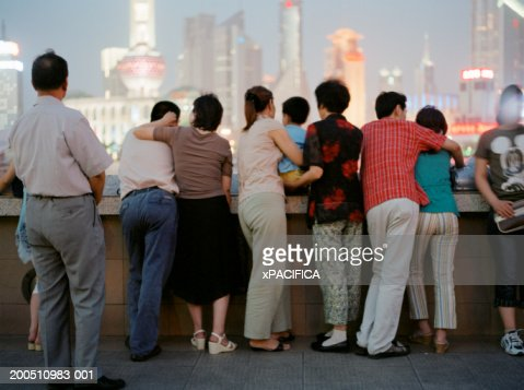 China, Shanghai, people looking at Pudong skyline, rear view : Stock Photo