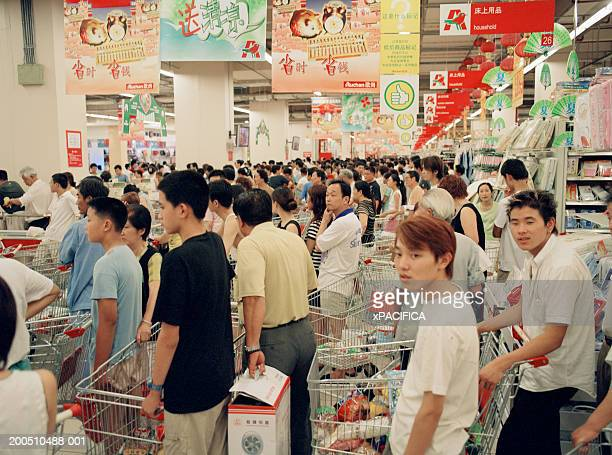 China, Shanghai, people queing up at hypermarket