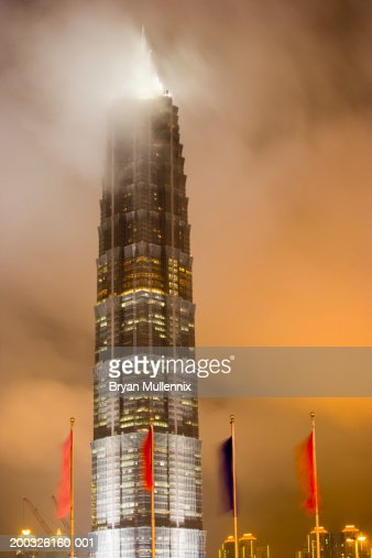 China, Shanghai, Pudong, Jin Mao Tower illuminated, night : Stock Photo