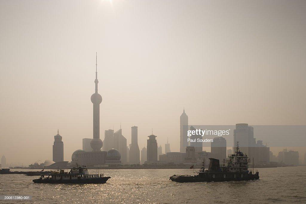 China, Shanghai, Pudong, skyline and boats on Huangpu River at dawn : Stock Photo