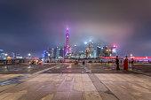 China, Shanghai, Skyline of Pudong with Bund Promenade at night