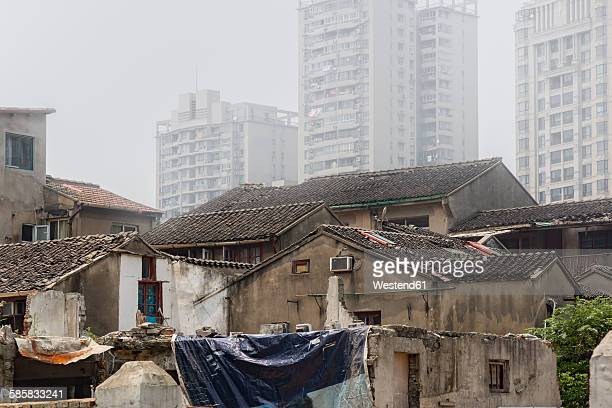 China, Shanghai, small old houses, modern highrises in the background