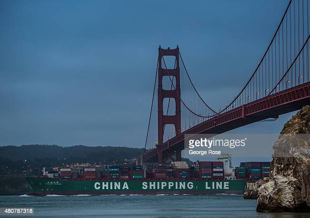 China Shipping Lines container ship passes under the Golden Gate Bridge before sunrise on June 23 in San Francisco California San Francisco continues...