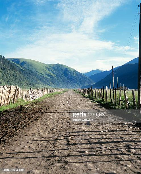 China, Sichuan Province, Kangding, dirt road in mountains