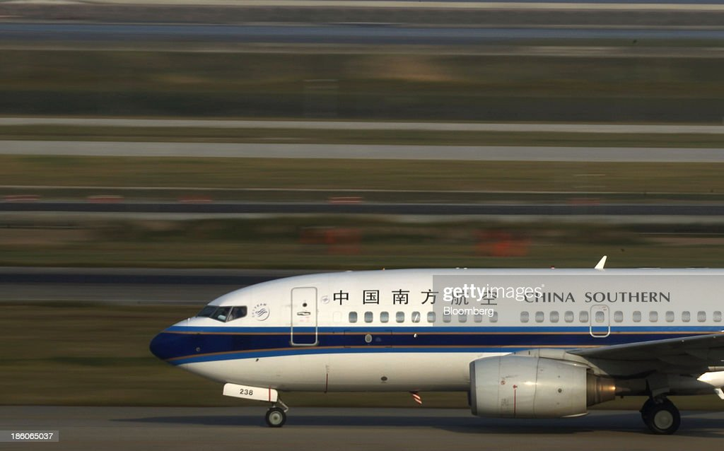 A China Southern Airlines Co. aircraft moves along the runway at Shanghai Pudong International Airport in Shanghai, China, on Saturday, Oct. 26, 2013. Airline profits worldwide in 2013 will be 7.9 percent smaller than estimated at $11.7 billion amid sluggish travel demand and rising oil prices tied to the Syria crisis, the International Air Transport Association said last month. Photographer: Tomohiro Ohsumi/Bloomberg via Getty Images