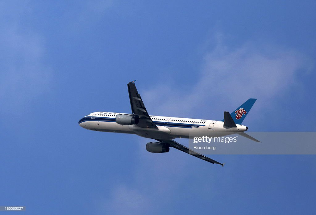 A China Southern Airlines Co. aircraft takes off at Shanghai Pudong International Airport in Shanghai, China, on Saturday, Oct. 26, 2013. Airline profits worldwide in 2013 will be 7.9 percent smaller than estimated at $11.7 billion amid sluggish travel demand and rising oil prices tied to the Syria crisis, the International Air Transport Association said last month. Photographer: Tomohiro Ohsumi/Bloomberg via Getty Images