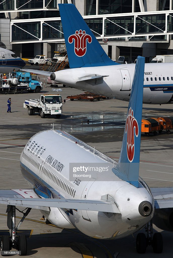 China Southern Airlines Co. aircrafts are parked at Shanghai Pudong International Airport in Shanghai, China, on Saturday, Feb. 9, 2013. A record 3.41 billion passenger trips may be made this year during the Lunar New Year period, according to the National Development and Reform Commission. Photographer: Tomohiro Ohsumi/Bloomberg via Getty Images