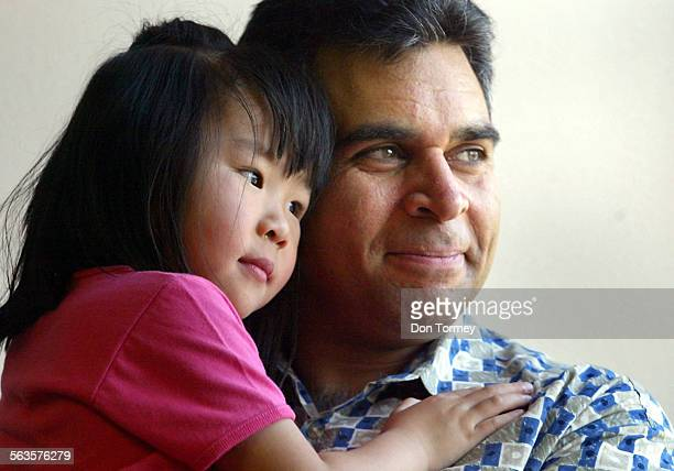 China usually sends 100 babies a week to the USA for adoption but the SARS epidemic has left prospective parents in limbo Parvaze Bashir cq gets hugs...